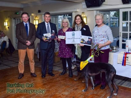 Alasdair MacCleod, winner of the Kennel Club Photographer of the Year Award in the category Assistance Dogs and Dog Charities, CCST Chairman Allan Sim, Heidi Hudson of the Kennel Club, Linda Wilkins and Megan (who was in the winning photo.)